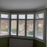 large bay window with modern white blinds