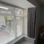 grey curtains with white blinds