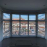 white blinds in bay window