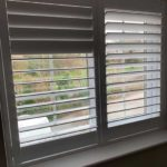 close up shot of new white blinds