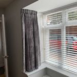 new blinds installed in modern grey and white living room