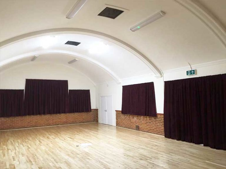 commercial flame retardant curtains fitted to village hall
