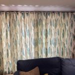 cream curtains with blue leaf print on