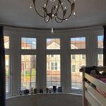 new curtains in large bay window